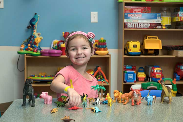 Young patient playing with toys